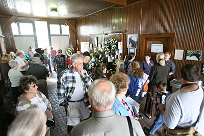 People visit John Henry's stall during a memorial service for champion John Henry at Kentucky Horse Park in Lexington, Ky., Friday afternoon, October 19, 2007. Photo by Matt Goins