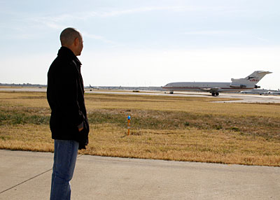 Mike Smith watches the plane carrying Zenyatta arrive in Louisville.