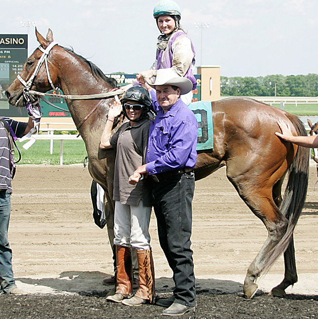 Cheyanna, Cindy, and Gary Patrick in winner's circle at Indiana Grand Race Course.