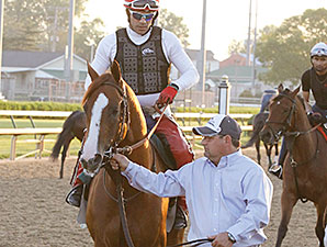 California Chrome jogs at Churchill Downs May 7.