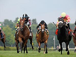 Daring Dancer wins the 2014 Lake George Stakes at Saratoga.