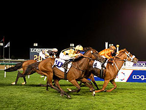Flying The Flag wins the 2015 Al Naboodah Construction Group Trophy Handicap.