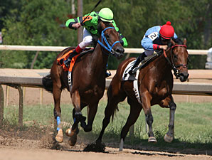 Foreign Girl (left) wins the 2011 LA Stallion Stakes Filly Division.