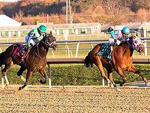 Gentlemen's Bet (Left) wins the Frank J. De Francis Memorial Dash over Trouble Kid (right) via DQ.