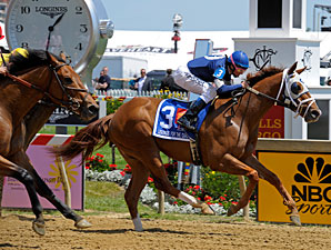 Haywired with Mary Russ Tortora wins the 2013 Lady Legends Race at Pimlico.