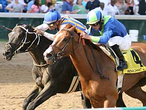 Indian Chant (no. 4) noses out Noonmark in the Aristides (gr. III) at Churchill Downs.
