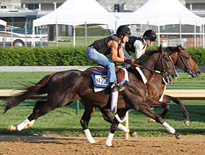 Jackson Bend (outside, with Carlos Correa up) works in company with stablemate Thomas Got Even (rail).