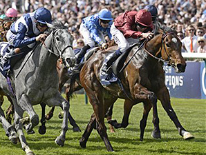 Just The Judge (IRE), maroon cap, running in the QIPCO One Thousand Guineas.