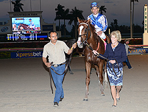 Lea heading to the winners circle following the Donn Handicap.