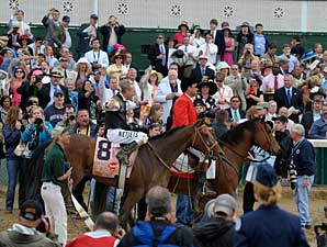 Mine That Bird and Calvin Borel are greeted by the crowd after winning the Kentucky Derby.