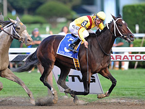 Rachel Holds Off Macho Again in Woodward