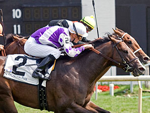 Reb Roars From Last to Win American Derby
