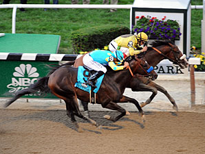 Union Rags holds off Paynter in the Belmont Stakes.