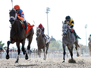 Unlimited Budget wins the 2013 Fair Grounds Oaks.