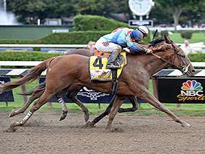 V. E. Day wins the 2014 Travers Stakes.