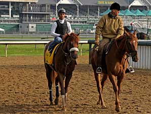 Visionaire is accompanied from the racetrack by trainer Michael Matz aboard his pony Wednesday morning at Churchill Downs.