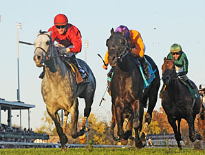 Court Vision, right, wins the Breeders' Cup Mile.